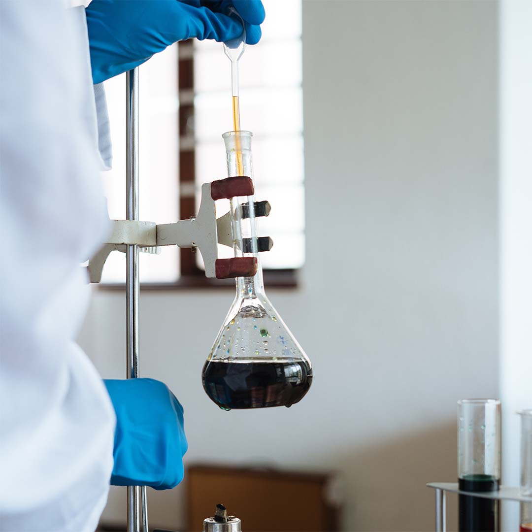 chemist-working with dark liquid x1080