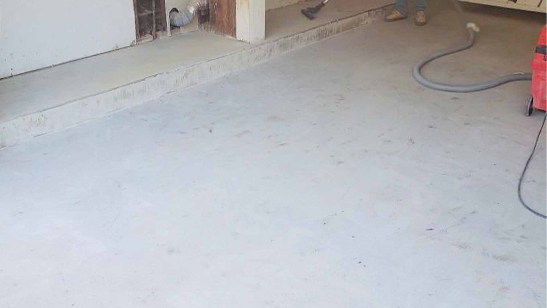 Blue metallic floor in utility garage area -BEFORE
