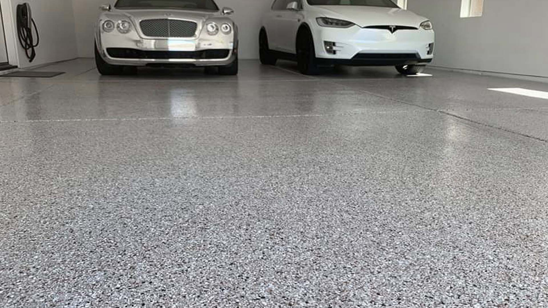 Flake floor in garage Bentley and Tesla -AFTER